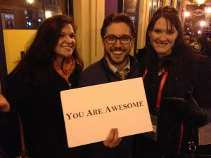 Becky Johnson, left, and Christa Woodall, right, appreciated one man's positive message in Park City's Main Street scene during Sundance Film Festival. (Photo courtesy of Christa Woodall)