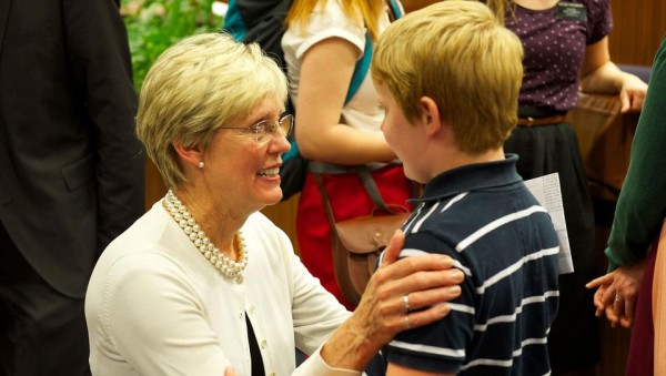 Sister Rosemary M. Wixom, then-general president of the Primary, visits with a boy in Austria in early summer 2014. (Photo courtesy Mormon Newsroom.)