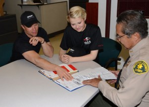 Operation Underground Railroad Founder Tim Ballard (left) and child rights activist Elizabeth Smart instruct Imperial County California's sheriff on what the county can do to protect children. (Photo by FletChet Entertainment)