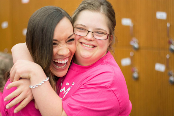 "Sarah Radford, right, hugs Whitney Talbert, ""Miss Teen Extraordinaire"" event director. Talbert started the pageant for special needs girls five years ago as Miss Spanish Fork."