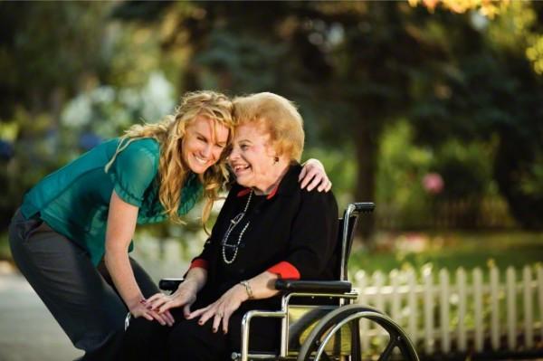 women-wheelchair-hugging-827992-gallery