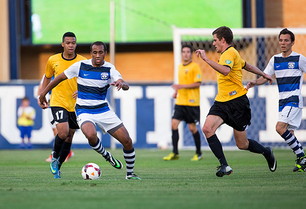 BYU defender Junior Lartey dribbles the ball up the field in a game.  (Photo courtesy BYU men's soccer team)