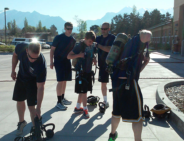 Fightfighters and community members put on air packs during Lehi Fire Department's workout like a firefighter event. The next chance for the community to train with firefighters is on Saturday, May 16. (Photo courtesy Lehi Fire Department)