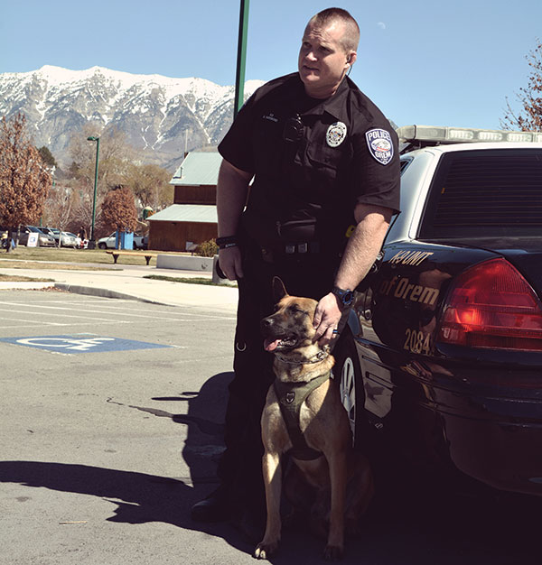 Officer Greer Haymond (with his K-9 partner, Rusty) goes above and beyond to serve and protect. The Orem patrol officer raised money and donations for a family that lost everything in a house fire just before Christmas.