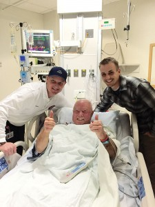 Ryan Kimball (left) visited Rick Ellison (center) the day after Rick was rescued from his American Fork Canyon hike while suffering a heart attack. Ryan hiked to a remote location and used a defibrillator to stabilize Rick until a LifeFlight helicopter that was equipped with a hoist could arrive. The next day, Ryan visited his new friend at Utah Valley Regional Medical Center in Provo. (Photo courtesy Ryan Kimball)