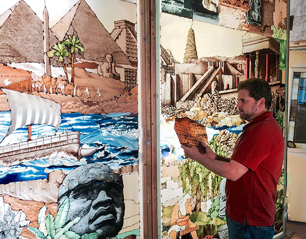 """Tom Holdman, who designed the stained glass windows for the Payson Utah Temple, works on his """"Roots of Knowledge"""" project that will go to Utah Valley University.  """"For us as artists, we have an individual art glass window that we spend days on and we have in our minds and hearts the moment that it can be held up to the light and then we act as a partnership with us, the glass and the light,"""" Holdman said about the stained glass at the Payson Utah Temple. """"It's wonderful that we have the temple to teach us about light and to grab ahold of the stained glass of the the 220,000 pieces of glass and let it sing. That is a moment that you will never forget."""""""