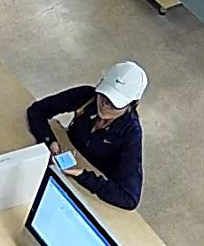 Orem police are looking for a woman accused of using a stolen credit card to buy thousands of dollars of items at Staples, Best Buy and Simply Mac on May 21. (Photo courtesy Orem police)