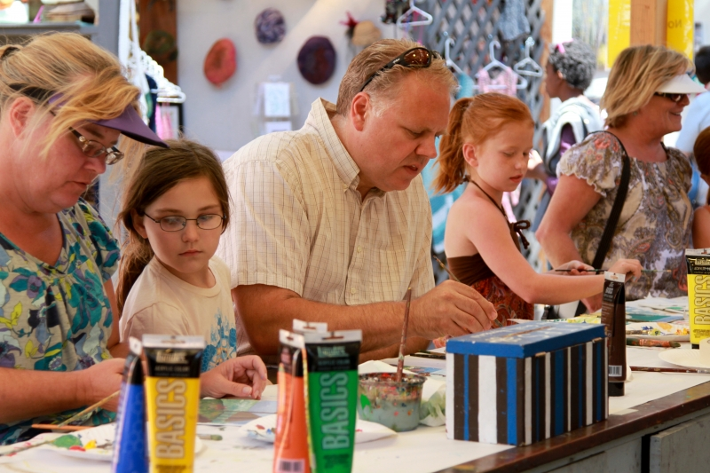 Visitors of all ages create their own masterpieces at one of the Sawdust Art Festival's free workshops. (Photo courtesy of Sawdust Art Festival)