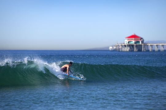 Huntington City Beach's world-famous waves make it home to the US Open of Surfing every summer. (Photo courtesy of Visit Huntington Beach)