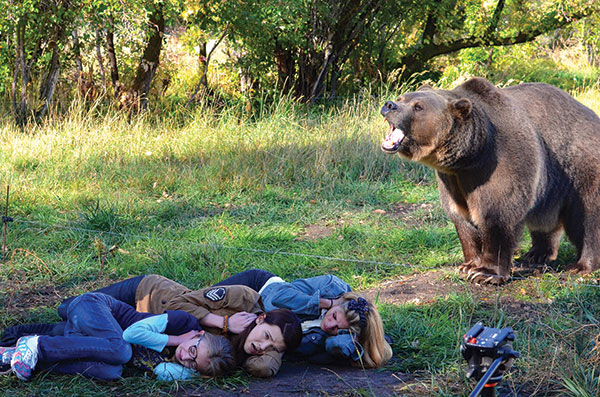 """No CGI here! Tank, a trained bear, lumbered on set for the filming of """"Once I Was a Beehive,"""" coming to Utah theaters  on August 14. (Photo courtesy """"Once I Was a Beehive"""")"""