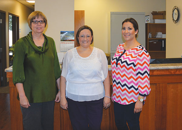 The staff at Small Employer Solutions in American Fork (led by Zara Quintana, center) started with the help of Central Bank. Now, they assist other small business owners in improving their bottom line.