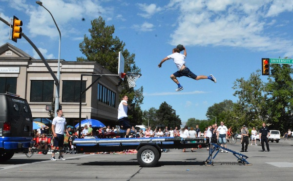 Cosmo's Crew performs tricks during the 2014 Freedom Festival Grand Parade. (Photo by Rebecca Lane)