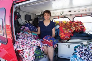 Cristy Daniels has made more than 2,000 blankets to comfort children and infants  in emergency situations. (Photo by Alisha Gallagher)