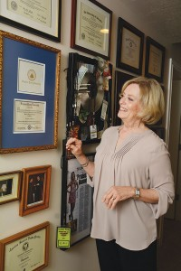 Shauna Valentine has dedicated a wall in her home to celebrating the highlights of her family's life — from college diplomas to award-winning records to magazine covers.
