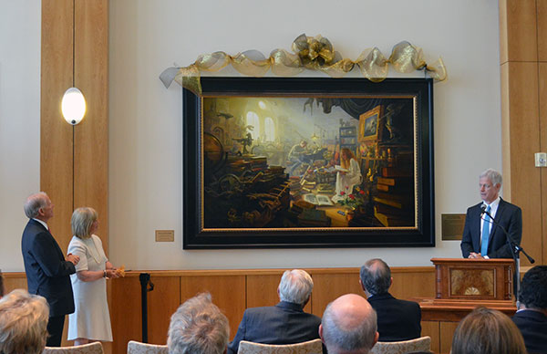 """Leo and Annette Beus (left) unveil Greg Olsen's new painting, """"Treasures of Knowledge."""" The Beuses commissioned Olsen to paint a picture for BYU's alumni center. (Photo by Rebecca Lane)"""