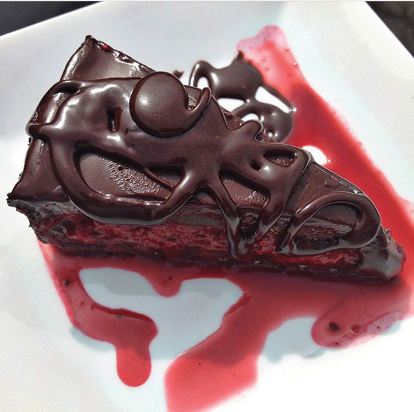 Chocolate Truffle Pie, shown here with raspberry sauce.