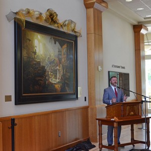"""Artist Greg Olsen speaks at the unveiling of his newest piece, """"Treasures of Knowledge."""" Olsen said this was """"one of the biggest endeavors I've made in my career."""" (Photo by Rebecca Lane)"""