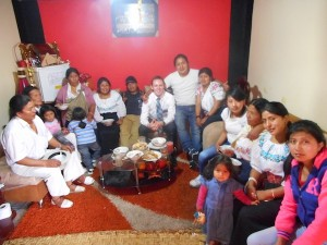 Ryan Call sits with a family from his LDS mission in Ecuador. (Photo courtesy Jeff Call)