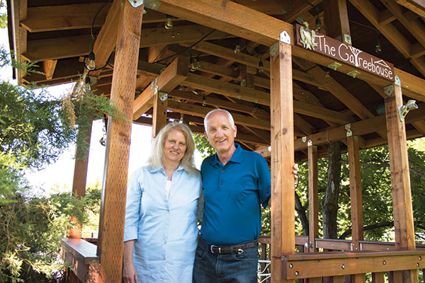 "Richard and Tammy Sheffield stand inside ""The Gatreebouse,"" a gazebo and treehouse hybrid Richard built. By working in their yard together, the couple continues a gardening tradition that began 15 years ago with Richard's late wife, Annette."