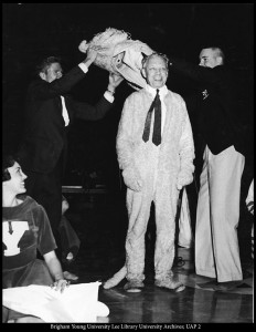 Unveiling Cosmo was a tradition until the suit upgrade in 1997. In 1960, Ernest L. Wilkinson, then-president of BYU, surprised students during Cosmo's unveiling. The actual Cosmo that year was Daniel T. Gallego, who was also BYU's first-ever Cosmo during 1953-54. (Photo courtesy BYU)