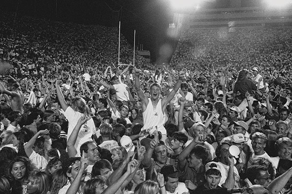 "BYU fans celebrate ""The Game"" victory over Miami (28–21) on Sept. 8, 1990. (Photo by Mark Philbrick/BYU Photo)"