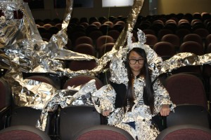 Peers turned Mountain View High School student Carmen Qin into a part of the artwork during an Areas for Action art workshop Wednesday with prominent contemporary artist Oliver Herring.