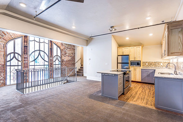 The brick wall and stained glass give this apartment a one-of-a-kind (and already-sold) charm. It took two years to construct the 15 single-bedroom units.