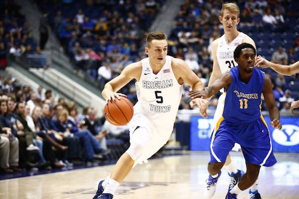 Senior Kyle Collinsworth dribbles the ball in the game against Alaska. (Photo by BYU Photo)