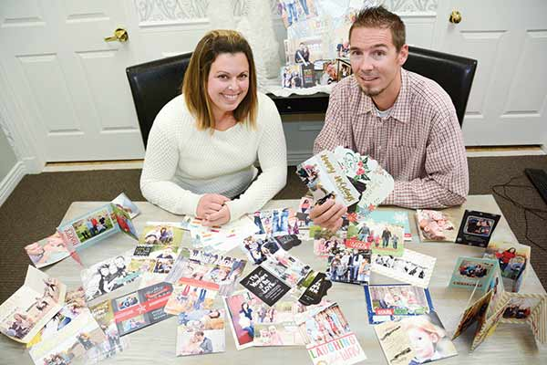 Husband-wife duo Cory and Veronica Chapman go through dozens of card designs every year to decide what's hot and what's not for each Christmas season.