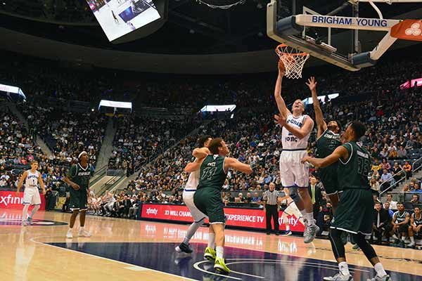 BYU junior Kyle Davis takes the ball to the basket over UVU's . Davis had 20 rebounds and 17 points in the game against UVU Friday night. (Photo by Rebecca Lane)