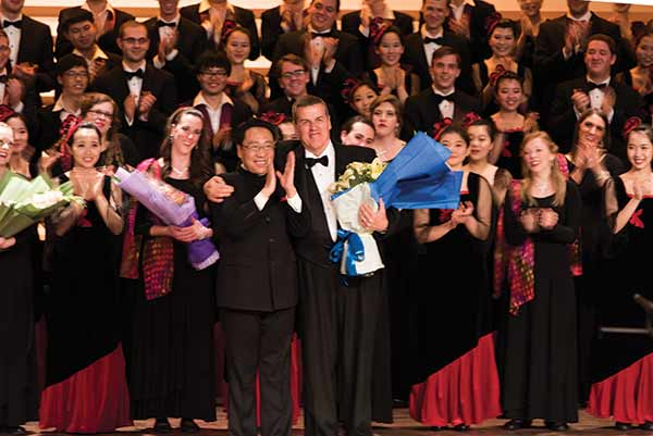 After leading the BYU Singers on a tour through China, Dr. Ronald Staheli retired as director of the elite ensemble. In China he spent hours posing for pictures after each performance — and is still sending autographs to his fans overseas. (Photo courtesy Sandefur Schmidt)
