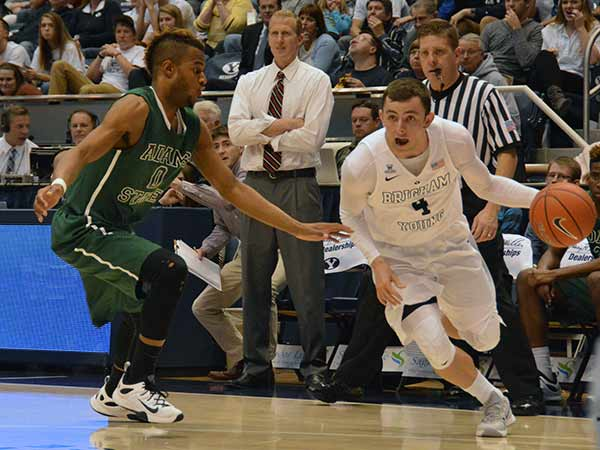 BYU freshman Nick Emery drives baseline in Friday's game against Adams State. (Photo by Rebecca Lane)