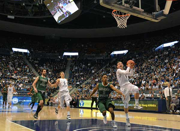 BYU freshman Nick Emery drives the ball to the basket against Adams State. Emery was the leading scorer with 20 points and 6 assists. (Photo by Rebecca Lane)