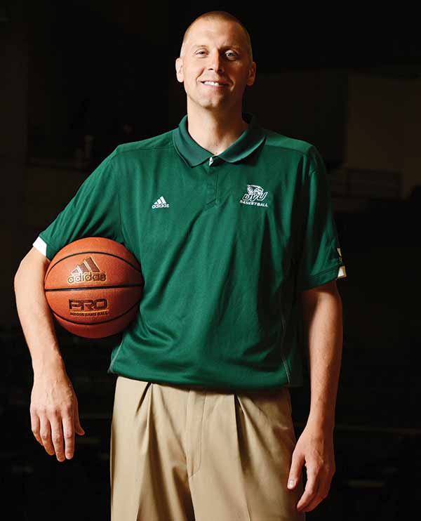 Mark Pope left the roster as an assistant coach at BYU to call the shots on the Wolverine sideline as UVU's new head basketball coach. (Photo by Dave Blackhurst)