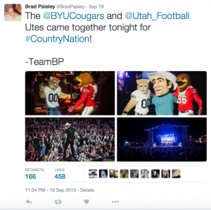 BYU's Cosmo hugged Utah's Swoop on stage at the Brad Paisley concert in September. (Image courtesy Brad Paisley's Twitter)