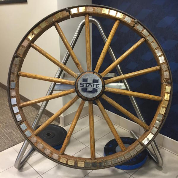 The Old Wagon Wheel serves as a trophy for the winning team between the BYU and Utah State football teams.