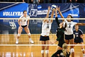 BYU players Whitney Young Howard (16) and Alexa Gray (9) block Ohio's setter in Friday night's game. The volleyball beat Ohio and Western Kentucky this weekend to advance to the Sweet Sixteen in the NCAA tournament. (Photo by BYU Photo)