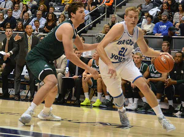 BYU junior Kyle Davis drives to the basket during a game against Utah Valley University earlier this year. Davis transferred from Utah State. (Photo by Rebecca Lane)