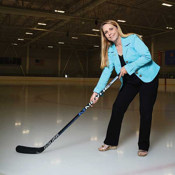 "Orem's Lori Weiss is a hockey-puck wielding grandma. She practices with the Provo Blades hockey team at the Peaks Ice Arena in Provo. ""It's great exercise and fun to be part of a team,"" she says."