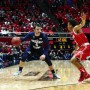 BYU guard Nick Emery dribbles the ball while Utah's Brandon Taylor defends him. Emery received a flagrant two foul after punching Taylor in the gut in Wednesday's night game at the Huntsman Center in Salt Lake. (Photo by Jaren Wilkey/BYU Photo)