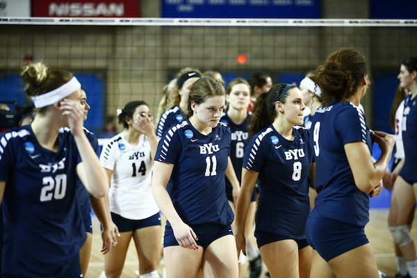 A disappointed BYU women's volleyball team leaves their match against Nebraska. The Cougars lost to the Huskers 3–0 in the Sweet 16. (Photo by BYU Photo)