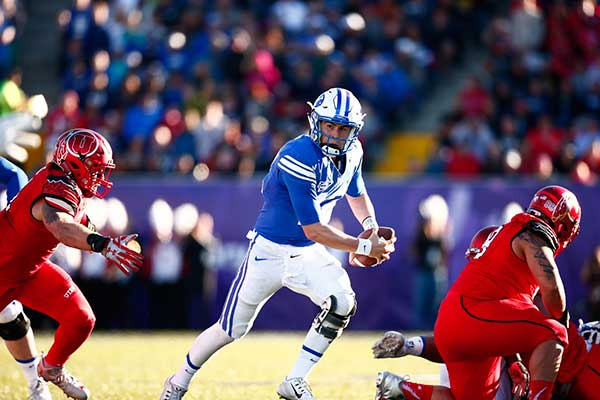 Tanner Mangum runs with the ball during BYU's 35–28 loss to Utah in the Royal Purple Las Vegas Bowl. (Photo by BYU Photo)