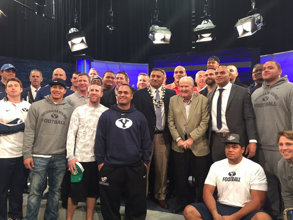 Kalani Sitake, BYU's new head football coach, stands in the center of former teammates next to LaVell Edwards following a press conference on Monday afternoon. (Photo by John Coon)