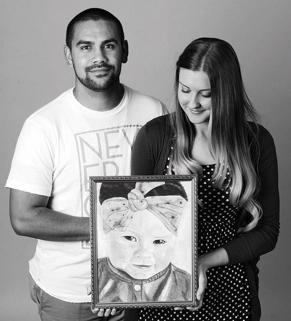 When local residents heard the Naulu's story, they gave donations, words of comfort, food and even art to express their support. An anonymous artist drew this portrait of Auni Naulu and left it on their doorstep. Caitlin and Dallin's 21-month-old daughter passed away from complications due to spinal muscular atrophy. (Photo by Alisha Gallagher)