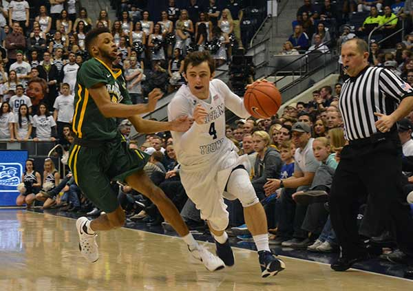 BYU freshman Nick Emery drives past a San Francisco defender in a game. Emery has been one of the top three scorers for BYU in the past three games. (Photo by Rebecca Lane)