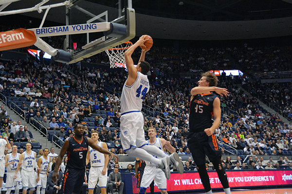 BYU sophomore Corbin Kaufusi dunks the ball during a game at the Marriott Center. (Photo by Rebecca Lane)