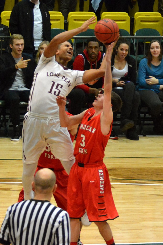 Frank Jackson scores with his left hand late in the game against the Cavemen Friday night.