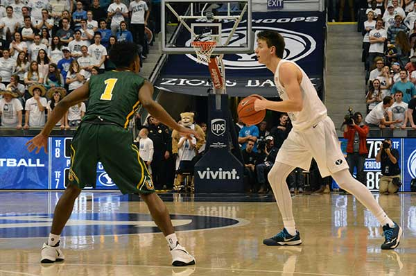 BYU freshman Zac Seljaas looks to pass the ball during BYU's 102–92 win over San Francisco. Seljaas had 20 points in the game, 18 of which were 3s. (Photo by Rebecca Lane)