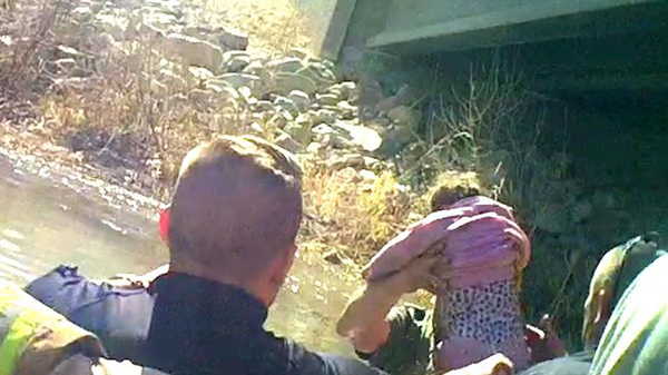 Spanish Fork police officers rescue 18-month-old Lily from a wreck in the Spanish Fork River. (Photo courtesy Spanish Fork Police Department)