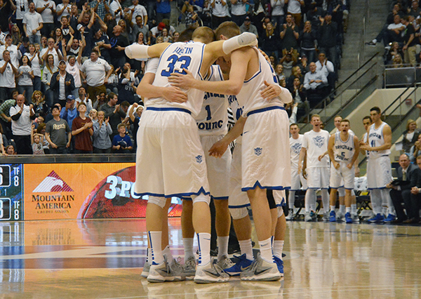 BYU's basketball team huddles together during a game at the Marriott Center. (Photo by Rebecca Lane)